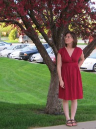 I got my boyfriend to take pictures of the dress out side our apartment building next to this really beautiful tree with flowers the same color as my dress. Only problem with him taking pictures is he would never tell me when he was taking it, so they didn't turn out all that great.