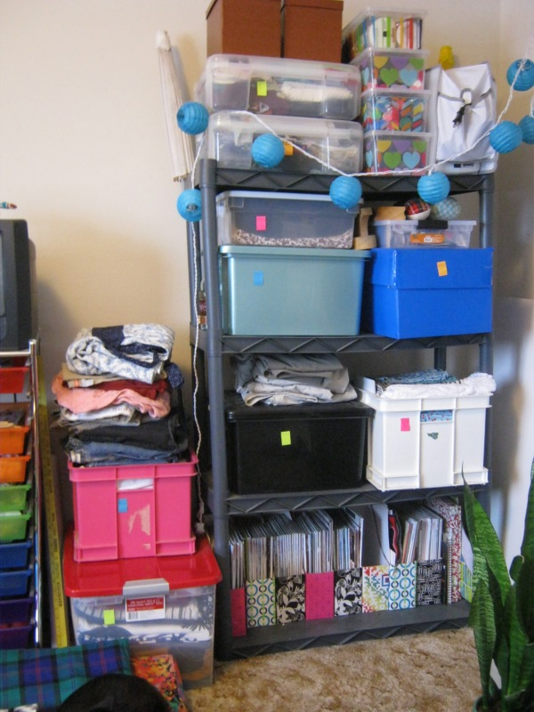 "This isn't all fabric, I also have magazines, notions, pressing tools and my ""travel"" sewing machine on these shelves."
