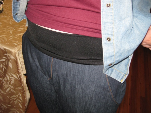 The waistband is not meant to be seen much, which is good because if it's not folded down (as pictured) they look a little like maternity pants.