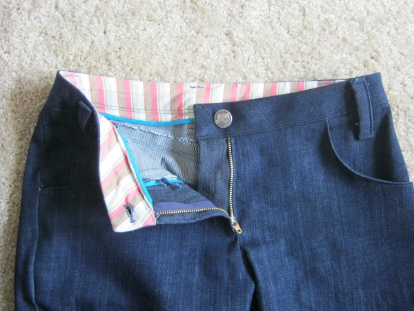 I bound the waistband facing because that's the way all my store bought pants are. Also buffalo nickle button!